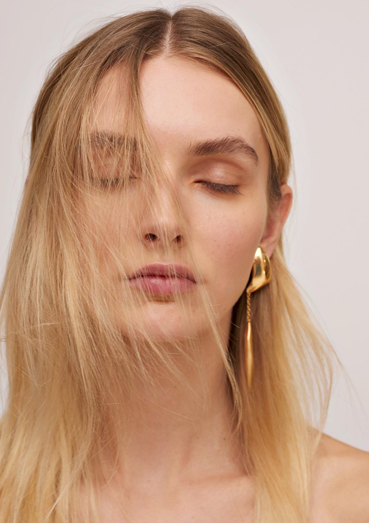statement earrings with long chain pendant in clean sculptural design in gold